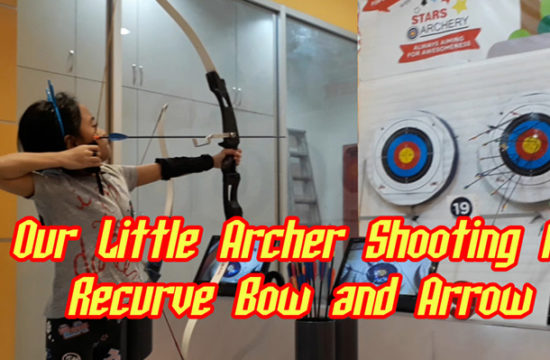 Little Archer Shooting A Recurve Bow and Arrow